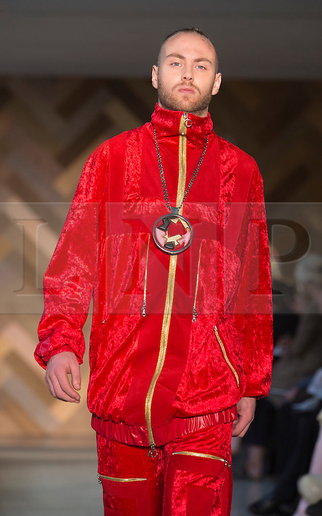 © Licensed to London News Pictures. 29/05/2014. London, England. Collection by Wonjee Chung. 30 students of the Royal College of Art's prestigious MA Fashion programme presented their final collections in  a runway show at the RCA building in Kensington. Photo credit: Bettina Strenske/LNP