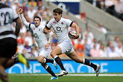 Ollie Devoto (England) goes on the attack - Photo mandatory by-line: Patrick Khachfe/JMP - Tel: Mobile: 07966 386802 01/06/2014 - SPORT - RUGBY UNION - Twickenham Stadium, London - England XV v Barbarians - International Friendly.