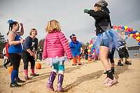 """Tom Turkey leads the """"warmup"""" prior to the 10th annual Turkey Plunge at Opechee Cove on Saturday afternoon.  (Karen Bobotas/for the Laconia Daily Sun)"""