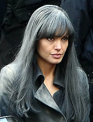 Actress Angelina Jolie wearing a black wig on the set of her upcoming spy thriller 'Salt' filming at the St. Bartholomew Church in New York.