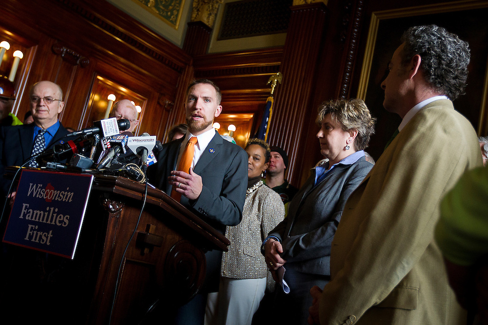 MADISON, WI — FEBRUARY 25: Wisconsin State Senator Chris Larson responds to a question during a press conference in the Wisconsin State Capitol on Wednesday before a legislative session discussing a right-to-work bill.