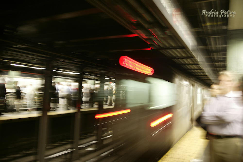 NYC subway train speeding out of Station