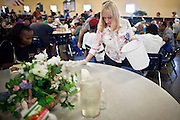 "Sept. 27 - PHOENIX, AZ: CAROL PICCO, a volunteer at the Society of St. Vincent de Paul in Phoenix, cleans tables during lunch service Monday, Sept 27. September 27, 2010 is the 350th Feast Day of Saint Vincent de Paul, also known as the ""Apostle of Charity."" To mark the day, the Society of St. Vincent de Paul in Phoenix served birthday cake during the lunch service. The US Census office recently announced that poverty in the US has spiked to 14.3% of the population, the highest poverty rate since 1994. Officials at St. Vincent de Paul in Phoenix said that demand for their services have increased steadily in the last three years. They currently feed about 1,100 people, either homeless or members of the working poor, every day.    Photo by Jack Kurtz"
