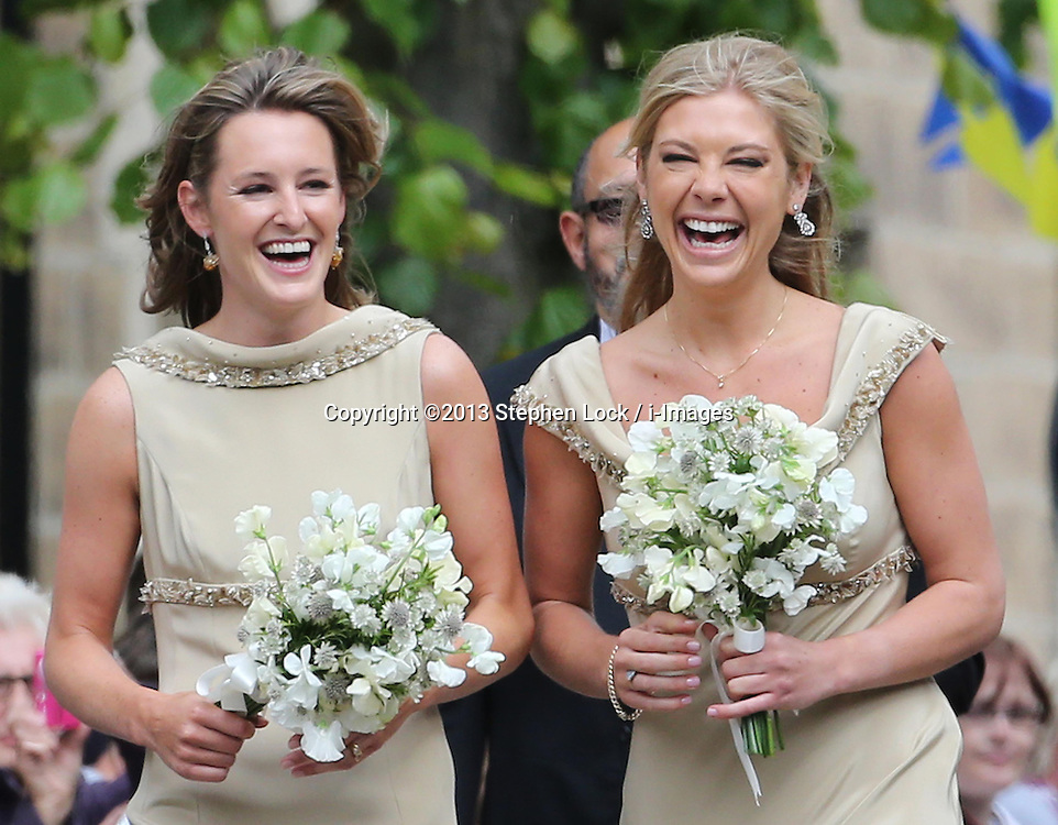 Bridesmaid Chelsy Davy (right) arriving  for the wedding of Lady Melissa Percy and Thomas van Straubenzee at St.Michaels Church, Alnwick, Northumberland Saturday, 22nd June 2013<br /> Picture by:  Stephen Lock / i-Images