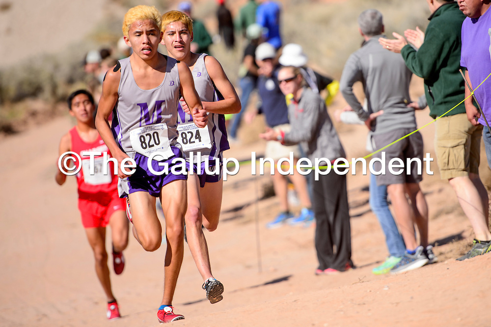 Miyamura Patriots Nicholas Jamison, left, and Niles Thomas pace one another for the lead in boys 5A race in the New Mexico State meet at Rio Rancho High School Saturday. Thomas finished first while Jamison held the number two spot.