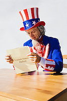 Uncle Sam sitting at a table looking at the United States Deficit.