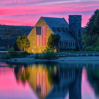 Abandoned Old Stone Church in West Boylston of Central Massachusetts on a beautiful sunset evening. New England colors photography of the historic landmark with church and sky colors reflecting in the Wachusetts Reservoir. <br />