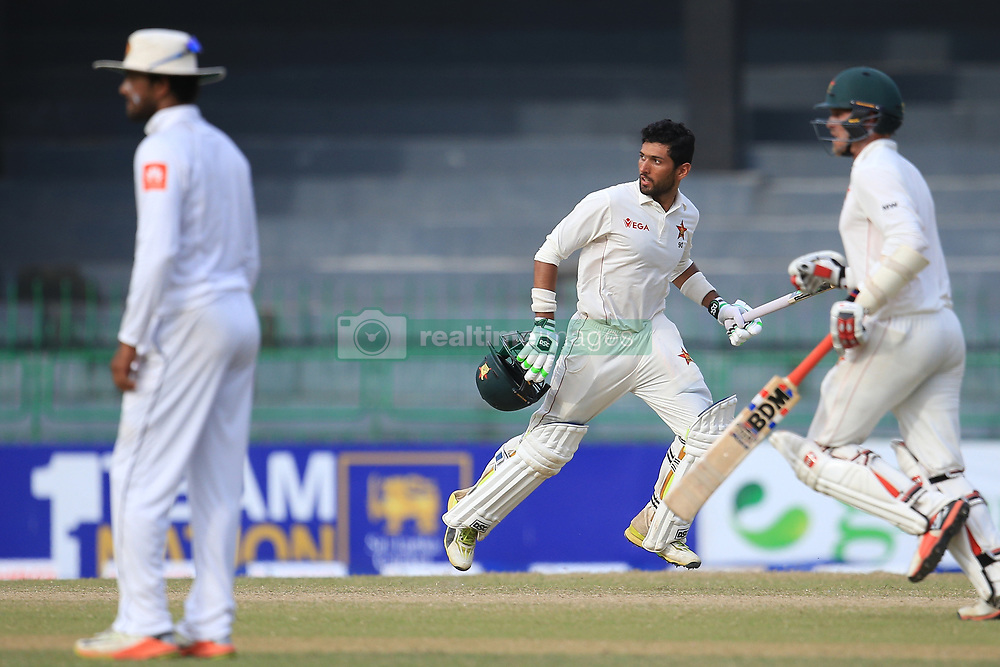 July 16, 2017 - Colombo, Sri Lanka - Zimbabwe cricketers Sikandar Raza (2R) and Malcolm Waller(R) run between the wickets as Sri Lankan captain Dinesh Chandimal(L) looks on during the third day's play of the only test cricket match between Sri Lanka and Zimbabwe  at R Premadasa International cricket stadium in Colombo, Sri Lanka, Sunday, July 16, 2017. (Credit Image: © Tharaka Basnayaka/NurPhoto via ZUMA Press)