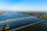 Nederland, Zuid-Holland, Hollands Diep, 07-02-2018; Hollandsch Diep, de grens tussen Brabant en Zuid-Holland met spoorbruggen: HSL-brug en de Moerdijkspoorbrug. In de voorgrond de brug voor het autoverkeer.<br /> Railwaybridges across Hollandsch Diep.<br /> luchtfoto (toeslag op standard tarieven);<br /> aerial photo (additional fee required);<br /> copyright foto/photo Siebe Swart