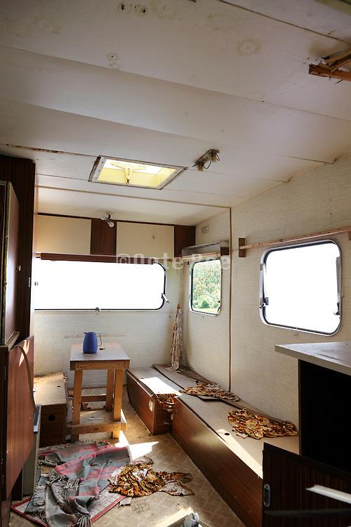 inside of a dilapidated caravan
