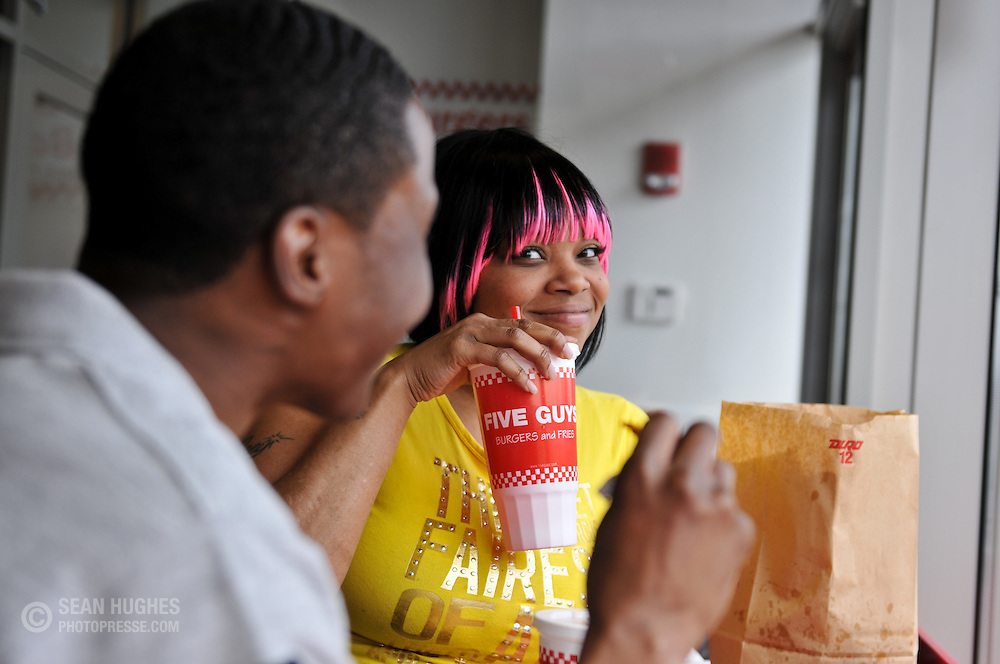 Five Guys in Clifton. Mechelle Wright (grey shirt) and Felicia Rivers (yellow shirt) enjoy their burgers.