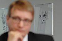 09 JAN 2007, BERLIN/GERMANY:<br /> Bild von Konrad Adenauer, im Hintergund von Ronald Pofalla, CDU Generalsekretaer, waehrend einem Interview, in seinem Buero, CDU Bundesgeschaeftsstelle<br /> IMAGE: 20070109-01-005