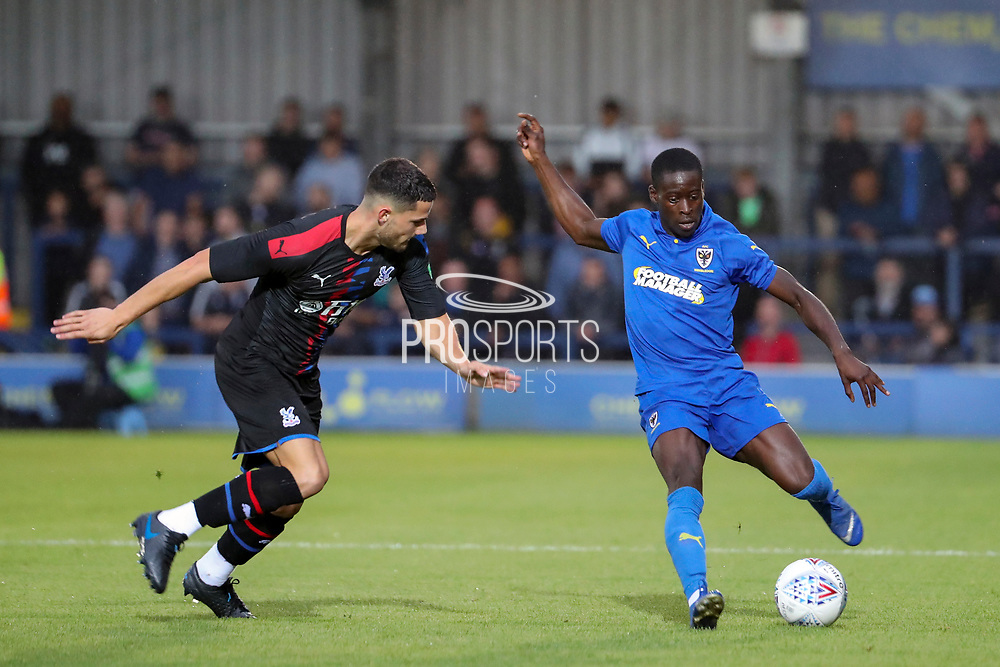 AFC Wimbledon defender Paul Osew (37) dribbling during the Pre-Season Friendly match between AFC Wimbledon and Crystal Palace at the Cherry Red Records Stadium, Kingston, England on 30 July 2019.