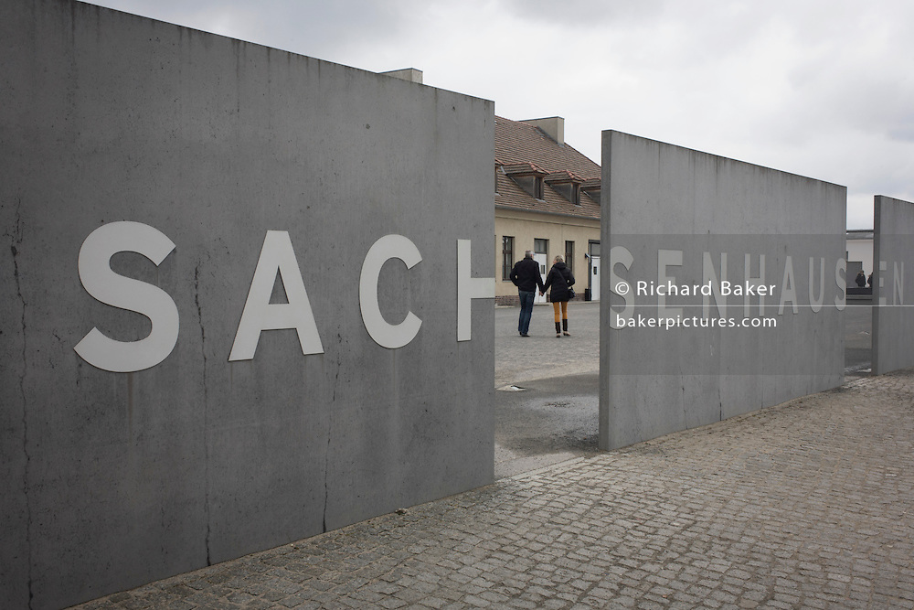A tourist couple enter the Sachsenhausen Memorial and Museum. Sachsenhausen was a Nazi and Soviet concentration camp in Oranienburg, 35 kilometres (22 miles) north of Berlin, Germany, used primarily for political prisoners from 1936 to the end of the Third Reich in May 1945. After World War II, when Oranienburg was in the Soviet Occupation Zone, the structure was used as an NKVD special camp until 1950. Executions took place at Sachsenhausen, especially of Soviet prisoners of war. 30,000 inmates died there from exhaustion, disease, malnutrition, pneumonia, etc. The remaining buildings and grounds are now open to the public as a museum.