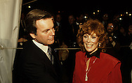 Robert Wagner and Jill St John arriving at a 20th Century Fox dinner during the visit of Queen Elizabeth II to California in March 1983...Photograph by Dennis Brack bb23