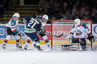 KELOWNA, CANADA - JANUARY 24:  Jordon Cooke #30 o f the Kelowna Rockets keeps his eye on the puck while defending the net against the Seattle Thunderbirds at the Kelowna Rockets on January 24, 2013 at Prospera Place in Kelowna, British Columbia, Canada (Photo by Marissa Baecker/Shoot the Breeze) *** Local Caption ***