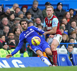 Chelsea's Cesc Fabregas and Burnley's Kieran Trippier compete for the ball - Photo mandatory by-line: Mitchell Gunn/JMP - Mobile: 07966 386802 - 21/02/2015 - SPORT - Football - London - Stamford Bridge - Chelsea v Burnley - Barclays Premier League