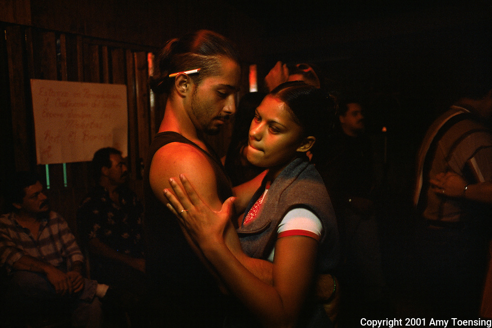 ADJUNTAS, PR - NOVEMBER 18: A couple dances in a bar November 18, 2000 in Adjuntas, Puerto Rico. Puerto Rico was an outpost of Spanish colonialism for 400 years, until the United States took possession in 1898. Today Puerto Rico's Spanish-speaking culture reflects its history - a mix of African slaves, Spanish settlers, and Taino Indians. Puerto Ricans fight in the U.S. armed forces but are not entitled to vote in presidential elections. They passionately debate their relationship with the U.S. with about half the island wanting to become the 51st state and the other half wanting to remain a U.S. commonwealth. A small percentage feel the island should be an independent country. While locals grapple with the evils of a burgeoning drug trade and unchecked development, drumbeats still drive the rhythms of African-inspired bomba music. (Photo By Amy Toensing) _________________________________<br />