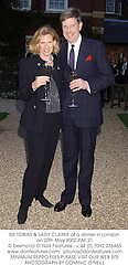 SIR TOBIAS & LADY CLARKE at a dinner in London on 20th May 2002.	PAF 21