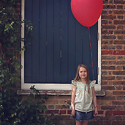 Girl with red balloon