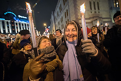 "10 December 2017, Oslo, Norway: In the evening of 10 December some 4,000 people from around the world gathered in central Oslo for a torch light march for peace. The event took place after the Nobel Peace Prize award 2017, awarded to the International Campaign to Abolish Nuclear Weapons (ICAN), for ""its work to draw attention to the catastrophic humanitarian consequences of any use of nuclear weapons and for its ground-breaking efforts to achieve a treaty-based prohibition of such weapons"". Among the crowd were more than 20 ""Hibakusha"", survivors of the atomic bombings in Hiroshima and Nagasaki, as well as a range of activists, faith-based organizations and others who work or support work for peace, in one or another way. Here, Anne Grete (left) and Kari (right), who have been active in ""No to Atomic Bombs"" in Norway, one of the partners in ICAN, for more than 40 years."