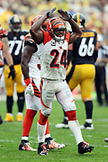 Cincinnati Bengals cornerback Adam Jones (24) yells out as he celebrates after intercepting a first quarter Pittsburgh Steelers pass at the Bengals 23 yard line during the 2016 NFL week 2 regular season football game against the Pittsburgh Steelers on Sunday, Sept. 18, 2016 in Pittsburgh. The Steelers won the game 24-16. (©Paul Anthony Spinelli)