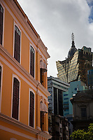 Contrast  of historic portuguese style colonial architecture with the shine of glass and steel of the Grand Lisboa in the background.