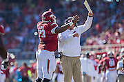 FAYETTEVILLE, AR - OCTOBER 25:  Head Coach Bret Bielema and Sebastian Tretola #73 of the Arkansas Razorbacks celebrate after Tretola throws a touchdown pass against the UAB Blazers at Razorback Stadium on October 25, 2014 in Fayetteville, Arkansas.  The Razorbacks defeated the Blazers 45-17.  (Photo by Wesley Hitt/Getty Images) *** Local Caption *** Bret Bielema; Sebastian Tretola
