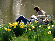 © Licensed to London News Pictures. 11/03/2012. Oxford, UK. A young couple read on the banks of the river. People enjoy the early morning sunshine on the River Cherwell in Oxford today 11 March 2012. Photo credit : Stephen SImpson/LNP