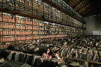 "PALERMO, ITALY - 16 JUNE 2018: Visitors watch the site-specific video installation ""Protocol no. 90/6"" by Masbedo is seen here in the Sala delle Capriate of the Archivio di Stato during Manifesta 12, the European nomadic art biennal, in Palermo, Italy, on June 16th 2018.<br /> <br /> Manifesta is the European Nomadic Biennial, held in a different host city every two years. It is a major international art event, attracting visitors from all over the world. Manifesta was founded in Amsterdam in the early 1990s as a European biennial of contemporary art striving to enhance artistic and cultural exchanges after the end of Cold War. In the next decade, Manifesta will focus on evolving from an art exhibition into an interdisciplinary platform for social change, introducing holistic urban research and legacy-oriented programming as the core of its model.<br /> Manifesta is still run by its original founder, Dutch historian Hedwig Fijen, and managed by a permanent team of international specialists.<br /> <br /> The City of Palermo was important for Manifesta's selection board for its representation of two important themes that identify contemporary Europe: migration and climate change and how these issues impact our cities."
