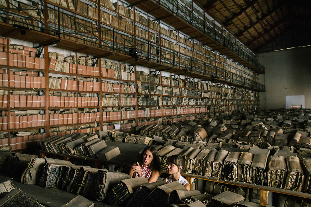 PALERMO, ITALY - 16 JUNE 2018: Visitors watch the site-specific video installation &quot;Protocol no. 90/6&quot; by Masbedo is seen here in the Sala delle Capriate of the Archivio di Stato during Manifesta 12, the European nomadic art biennal, in Palermo, Italy, on June 16th 2018.<br /> <br /> Manifesta is the European Nomadic Biennial, held in a different host city every two years. It is a major international art event, attracting visitors from all over the world. Manifesta was founded in Amsterdam in the early 1990s as a European biennial of contemporary art striving to enhance artistic and cultural exchanges after the end of Cold War. In the next decade, Manifesta will focus on evolving from an art exhibition into an interdisciplinary platform for social change, introducing holistic urban research and legacy-oriented programming as the core of its model.<br /> Manifesta is still run by its original founder, Dutch historian Hedwig Fijen, and managed by a permanent team of international specialists.<br /> <br /> The City of Palermo was important for Manifesta&rsquo;s selection board for its representation of two important themes that identify contemporary Europe: migration and climate change and how these issues impact our cities.