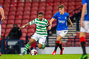 Karamoko Dembele (#7) of Celtic FC runs past Ben Williamson (#4) of Rangers FC during the Scottish FA Youth Cup Final match between Celtic and Rangers at Hampden Park, Glasgow, United Kingdom on 25 April 2019.