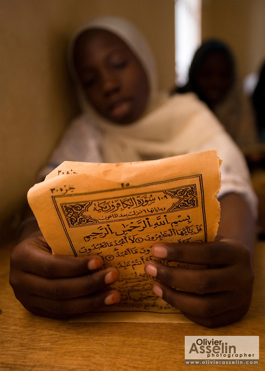 A girl holds a page with inscriptions in arabic at the Mame Diarra Bousso koranic school in the village of Porokhane, Senegal, on Monday June 18, 2007.