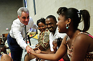 "Chicago Mayor Rahm Emanuel (L) greets family members of the first graduating class of Christ the King Jesuit College Preparatory School prior to a commencement ceremony on Saturday, June 9th 2012. Emanuel applauded the 50 students for beating the odds, adding in his address that ""They had every excuse available for why they couldnÕt graduate or go to college. But instead of settling for otherÕs peopleÕs easy excuses, they set their own high expectations. Their accomplishment this weekend stands as a rebuke to anyone who adopts a cynical attitude about what the students of Chicago, even in the roughest neighborhoods, can accomplish"".  Brian J. Morowczynski~ViaPhotos..For use in a single edition of Catholic New World Publications, Archdiocese of Chicago. Further use and/or distribution may be negotiated separately. ..Contact ViaPhotos at 708-602-0449 or email brian@viaphotos.com."
