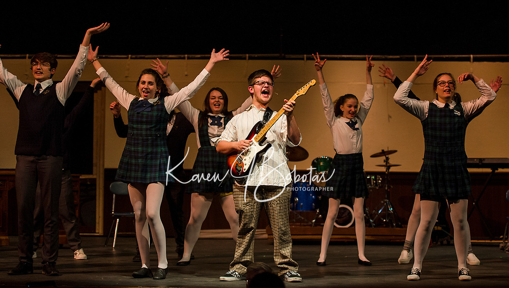 """""""Dewey Finn"""" Jonathan Buttrick convinces his students to play in a rock band during dress rehearsal for School of Rock at Gilford High School Tuesday evening.  (Karen Bobotas/for the Laconia Daily Sun)"""