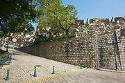 Macau, China - September 11, 2013: Exterior wall of the Guia Fortress at Caminho dos Artilheiros street in Macau, China.