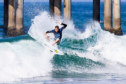 Mitch Crews (AUS) advances to Round 2 of the 2018 VANS US Open of Surfing after winning Heat 4 of Round 1 at Huntington Beach, California, USA.
