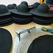 VENICE, ITALY - JANUARY 20: A general view of hats and hatmaker instruments are seen at the  historic atelier Pietro Longi on January 20, 2012 in Venice, Italy. This is one of the busiest periods of the year for the atelier as the next few weeks the streets and canals of Venice will be filled with people attending the carnival,  wearing highly-decorative and imaginative carnival costumes and masks.