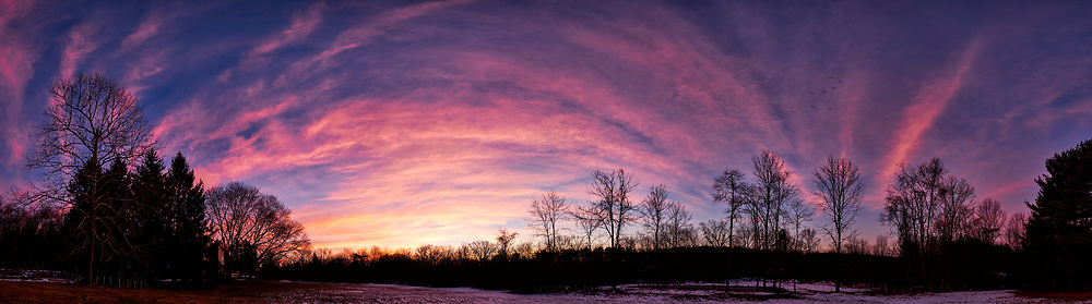 Dawn Morning Clouds. Winter Backyard Nature in New Jersey. Composite of 11 images taken with a Fuji X-T1 camera and 16 mm f/1.4 lens (ISO 200, 16 mm, f/5.6, 1/30 sec). Raw images processed with Capture One Pro and the composite generated with AutoPano Giga Pro.