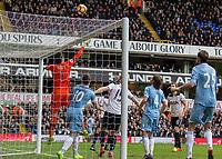 Football - 2016 / 2017 Premier League - Tottenham Hotspur vs. Stoke City<br /> <br /> Hugo Lloris of Tottenham tips the ball over the bar at White Hart Lane.<br /> <br /> COLORSPORT/DANIEL BEARHAM