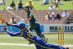 © Licensed to London News Pictures. 08/03/2012. Adelaide Oval, Australia. .Matthew Wade edges one past Lahiru Thirimanne during the One Day International cricket match final between Australia Vs Sri Lanka. Photo credit : Asanka Brendon Ratnayake/LNP.