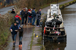 Arriving supporters buy oatcakes from a canal boat moored outside the stadium - Photo mandatory by-line: Rogan Thomson/JMP - 07966 386802 - 01/01/2015 - SPORT - FOOTBALL - Stoke-on-Trent, England - Britannia Stadium - Stoke City v Manchester United - New Year's Day Football - Barclays Premier League.