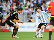 CAPE TOWN, SOUTH AFRICA- Saturday 3 July 2010, Lionel Messi and Sami Khedira during the quarter final match between Argentina and Germany held at the Cape Town Stadium in Green Point during the 2010 FIFA World Cup..Photo by Roger Sedres/Image SA
