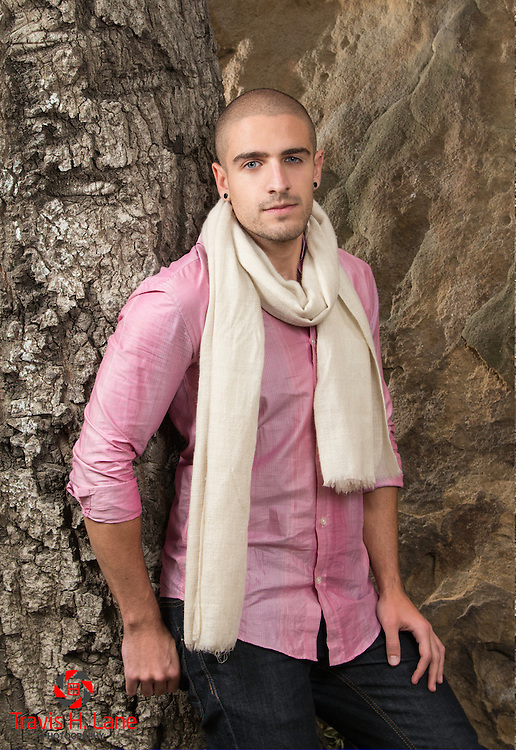 Joey Hakim in a pink shirt with a scarf