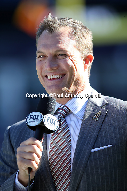 Sportscaster and former NFL safety John Lynch has a hearty laugh as he does a sideline report before the New England Patriots 2015 week 9 regular season NFL football game against the Washington Redskins on Sunday, Nov. 8, 2015 in Foxborough, Mass. The Patriots won the game 27-10. (©Paul Anthony Spinelli)