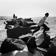 Photo: Mark Chilvers/Insight..Fishing off of the rocks at Coney Island, New York, USA. 1999..