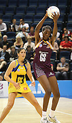 Out in front, Romelda Aiken takes the ball without any trouble. ANZ Netball Championship. Round 3 - Queensland Firebirds v Central Pulse. Played at Brisbane Convention Centre. Firebirds (56) defeated the Pulse (28).  Photo: Warren Keir (SMP/Photosport NZ).<br /> <br /> Use information: This image is intended for Editorial use only (e.g. news or commentary, print or electronic). Any commercial or promotional use requires additional clearance.