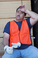Warehouse worker cooling off from work pressure