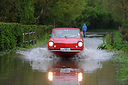 Dave beats the floods  in a 1977 Amphicar in Tewkesbury  on May 1st 2012 as UK record rainfall causes flooding..Photo Times Photographer /Ki Price .....