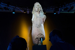 "© Licensed to London News Pictures. 01/11/2019. LONDON, UK. ""Colossal Quartzite Statue of Tutankhamun, Usurped by Ay and Horemheb"". Preview of ""Tutankhamun, Treasures of the Golden Pharoah"" at the Saatchi Gallery in Chelsea.  The exhibition celebrates the 100th year anniversary of the opening of Tutankhamun's tomb and displays 150 works in the largest collection of Tutankhamun's treasures ever to leave Egypt.  The show runs 2 November to 3 May 2020.  Photo credit: Stephen Chung/LNP"